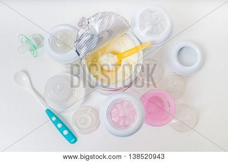 Bottles And Milk Formula In Can For Feeding Infant.