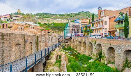 TBILISI GEORGIA - MAY 28 2016: The numerous sulphur baths of Abanotubani neighborhood attract the tourist and locals on May 28 in Tbilisi.