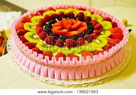 Summer cake with fresh fruits strawberries kiwi raspberries and fresh cheese