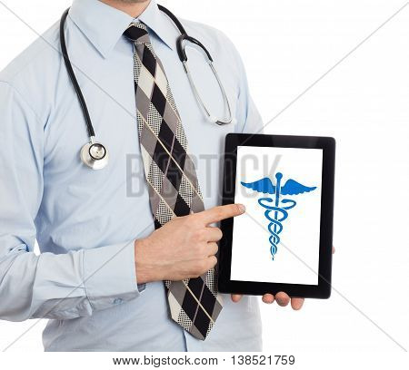 Doctor holding tablet isolated on white - Caduceus symbol