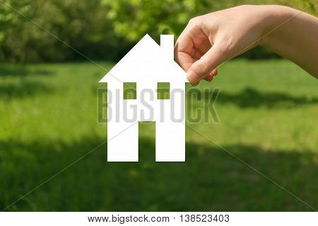 Hand Holding Cut Off Paper House As Symbol Of Mortgage