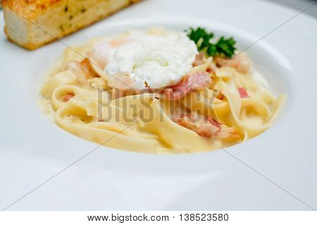 Carbonara Spaghetti  with  bacon and egg on white plate