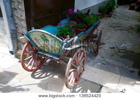 Old wagon with flowers raritet history Nesebar. Bulgaria.