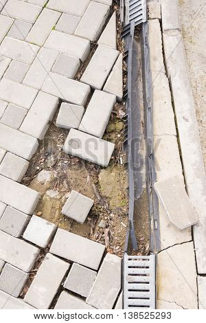 The Destruction Of The Pedestrian Walkway Of Stone Tiles With Drainage