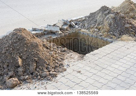 Dug A Pit For Planting Trees On The Pavement Of Paving Slabs