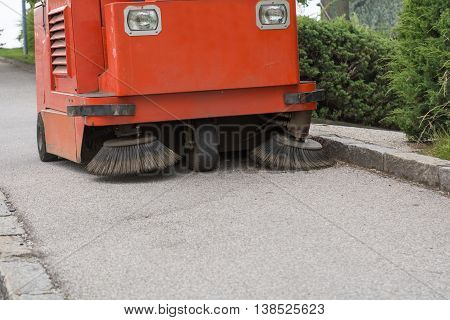 Cleaning off the sidewalk with cleaning machine