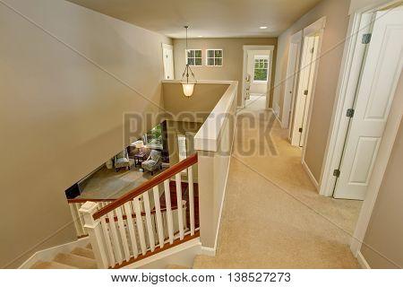Hallway Interior With Carpet Floor And Beige Walls