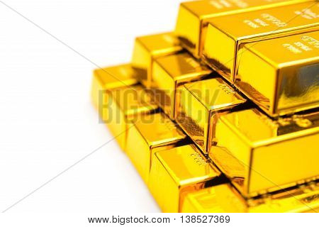 pieces of gold bars stacked up on a white background
