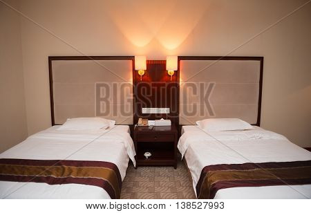 two beds in a hotel room horizontal composition