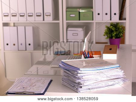 Office desk and a bundle of documents.