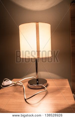 Modern table lamp on a bedside table lamp is on