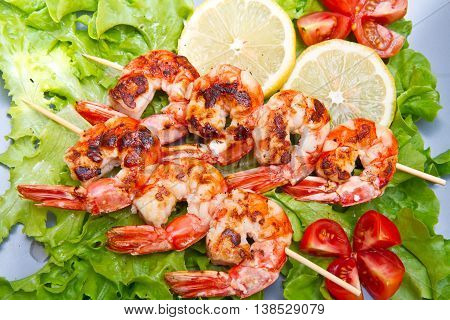 some grilled prawn with salad and lemon