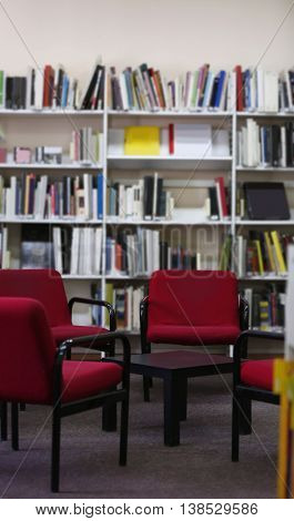 Modern library interior with red chairs