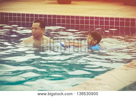 Parent And Child Playing Outdoors. Summer Vacation Concept
