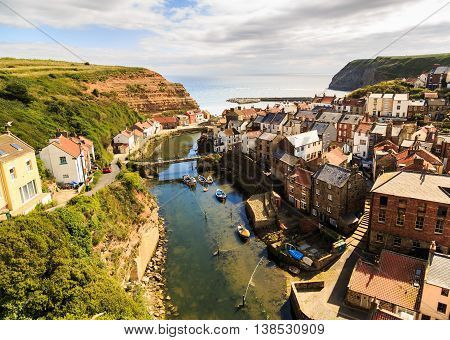 STAITHES ENGLAND - JULY 12: View of Staithes from a high viewpoint showing the beck and the town. In Staithes North Yorkshire England. On 12th July 2016.