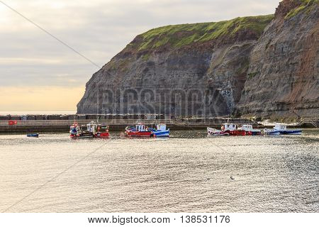STAITHES ENGLAND - JULY 12: Fishing boats moored up in the harbour. In Staithes North Yorkshire England. On 12th July 2016.