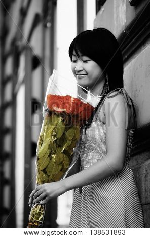 Asian girl with bunch of roses