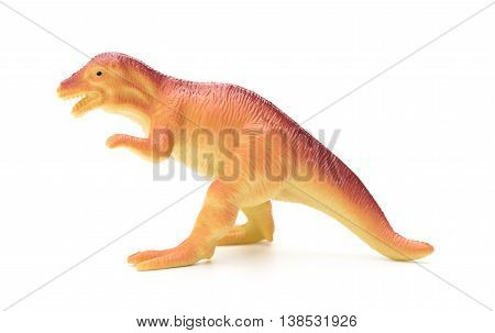 side view orange plastic dinosaur toy on a white background