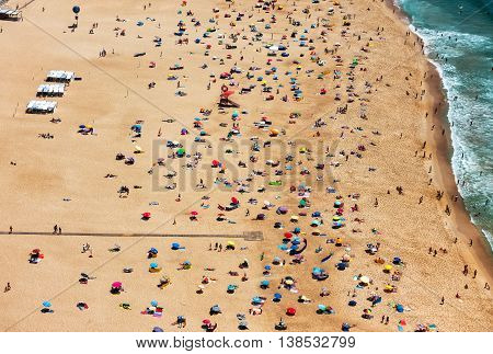 Beach From Above With Many Umbrellas And People