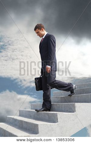 Image of sad businessman walking downstairs