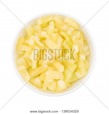 yellow sliced pepper in a white bowl. isolated on white background.