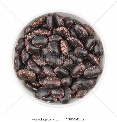 dried beans in bowl on white background