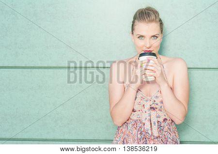Young Girl Posing Holding Takeaway Coffee Mug