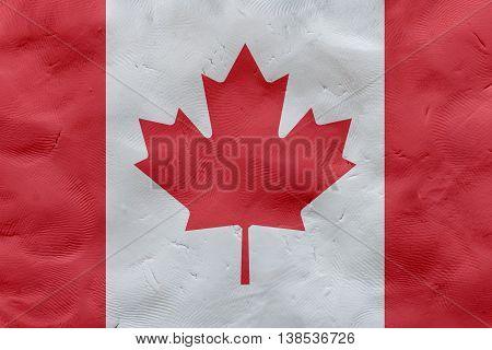 Canadian national flag made of plasticine (national symbol).