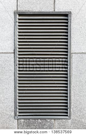 Metal Ventilation Grille In Gray Industrial Wall