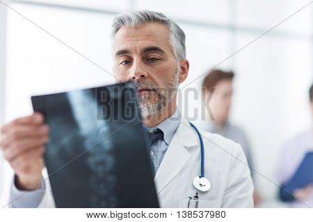 Radiologist examining a patient's x-ray medical staff on the background healthcare concept