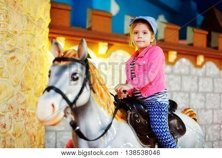 Girl Riding   A Carousel Horse