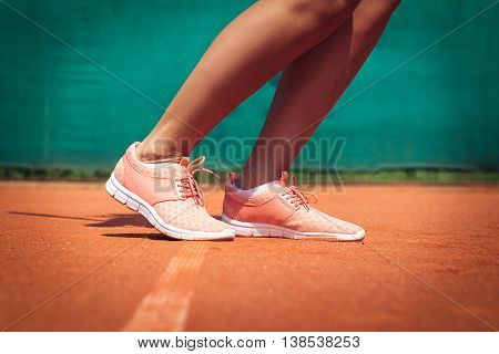 Legs of female tennis player. Close up image