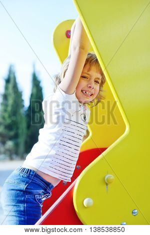 a sweet happy girl on the playground