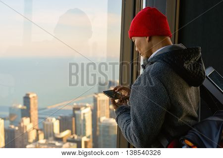CHICAGO, IL - CIRCA MARCH, 2016: visitor at John Hancock Center's observatory. The John Hancock Center is a supertall skyscraper at 875 North Michigan Avenue, Chicago.