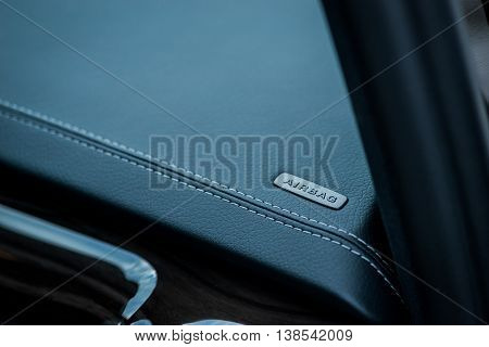 Luxury car interior details. Airbag badge on dashboard