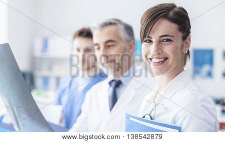 Medical Team Examining An X-ray