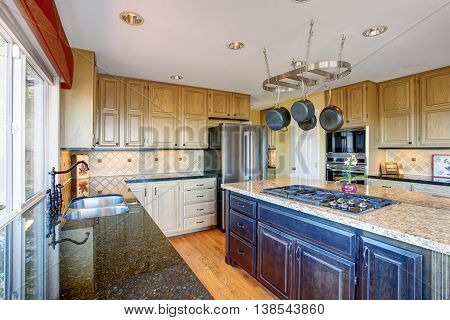 View Of Modern Kitchen Room Interior With Kitchen Island And Honey Color Cabinets.