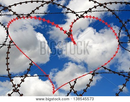 Natural heart shape (digitally coloured red) in a barbed wire fence on sky background. Love, freedom, peace, hope and compassion concepts.