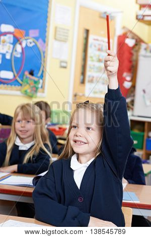 Girl In Elementary School Class Answering Question
