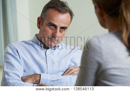 Depressed Mature Man Talking To Female Counsellor
