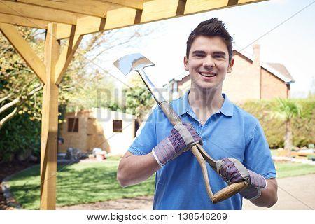 Portrait Of Smiling Landscape Gardener Holding Spade