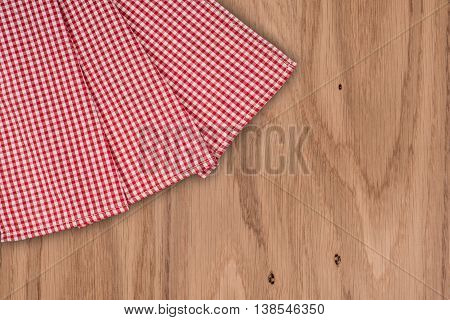 white old vintage wooden table with red checker napkin
