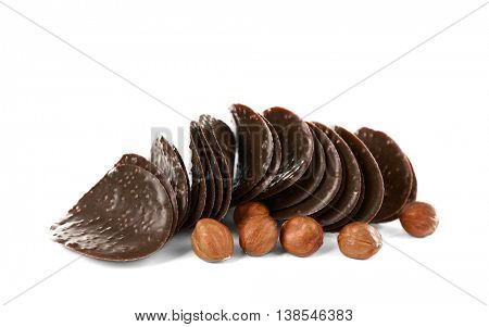 Chocolate chips and hazelnuts on white background
