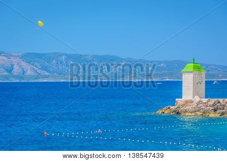 Daylight view at lighthouse in town Bol on Island of Brac and Adriatic sea in Croatia, summertime.