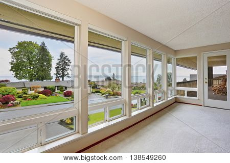 Empty Room With Large Windows And Carpet Floor.