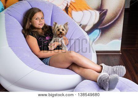 Girl Hugging A Yorkshire Terrier