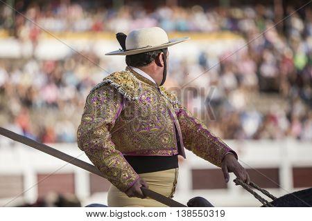 Linares SPAIN - August 28 2014: Picador bullfighter lancer whose job it is to weaken bull's neck muscles in the bullring for Linares Spain