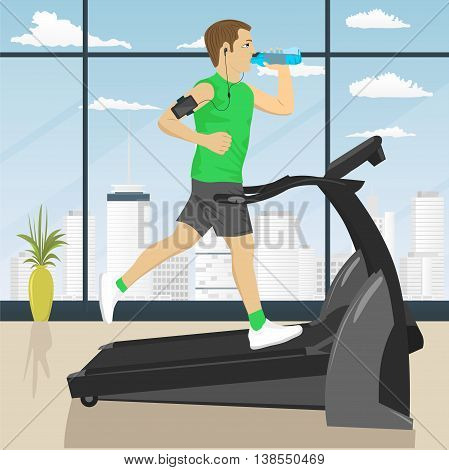 man at the gym doing exercise on the treadmill with smartphone armband drinking water