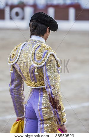 Linares Spain - August 28 2014: The Spanish Bullfighter Sebastian Castella bullfighting with the crutch in the Bullring of Linares Spain