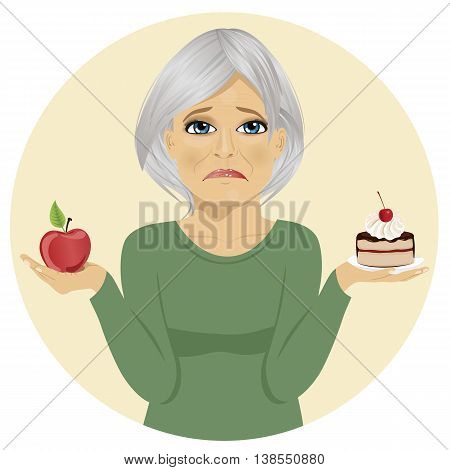 Sad senior woman choosing between chocolate layer cake and an apple for dessert